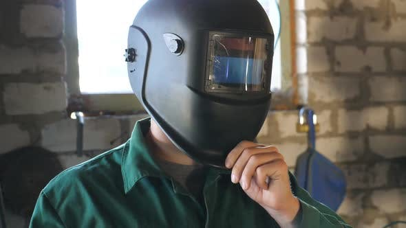 Thumbnail for Welder Opens Mask and Looking at Camera