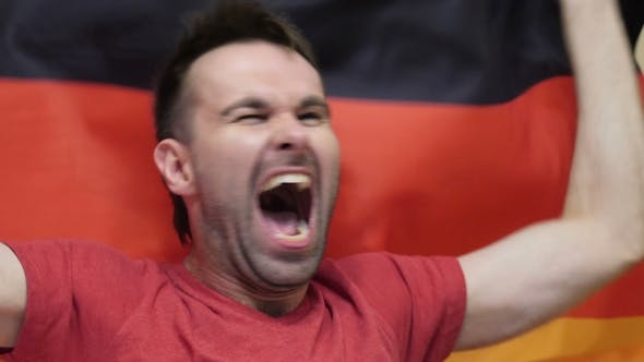 Thumbnail for German Fan Celebrating While Holding the Flag of Germany