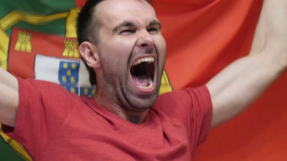 Thumbnail for Portuguese Fan Celebrating While Holding the Flag of Portugal