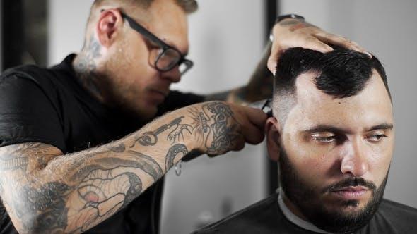 Thumbnail for Tattoed Barber Makes Haircut for Customer at the Barber Shop By Using Hairclipper, Man's Haircut and
