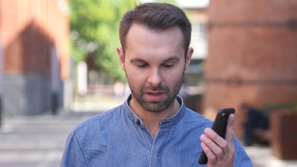 Thumbnail for Portrait of Casual Man Talking on Phone