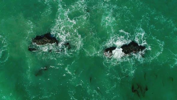 Thumbnail for Oceanic Waves Are Broken Up Into Rocks. View From the Top. Malibu, California