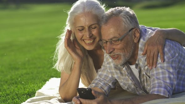 Thumbnail for Happy Seniors Enjoying Modern Device