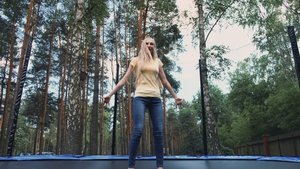 Thumbnail for Happy Female Jumping on Trampoline