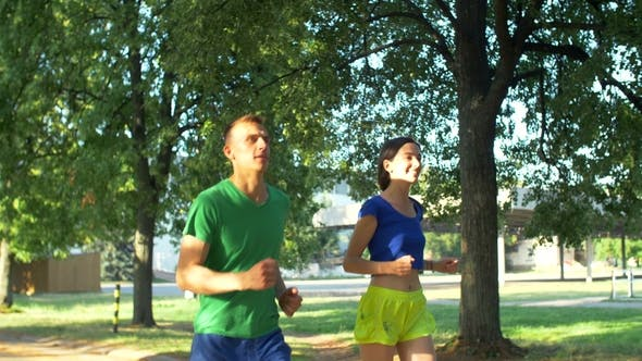Thumbnail for Healthy Active Couple Runners Meeting Friends in Park