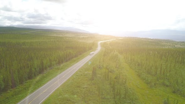 Thumbnail for Truck Rides the Road. Aerial Flythrough of Beautiful Alaska. July 2017
