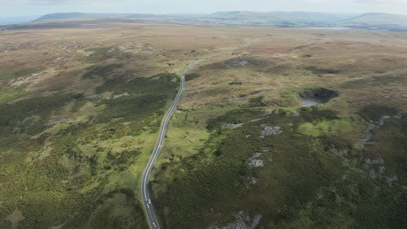 Thumbnail for Aerial drone view of a small, winding mountain road