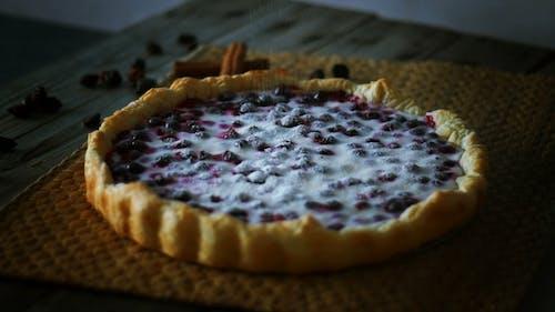 Adding Powdered Sugar on the Pie