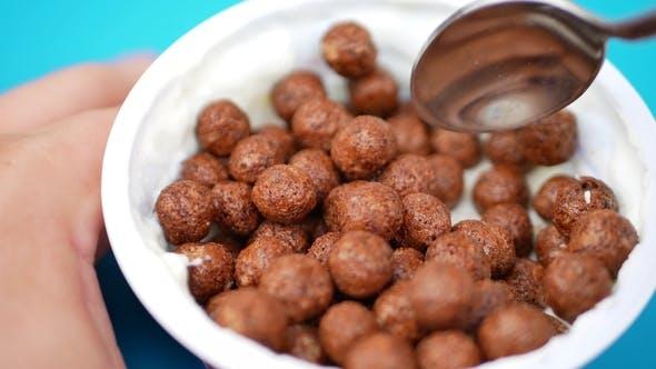 Thumbnail for Jar of Yogurt with Spoon and Chocolate Balls