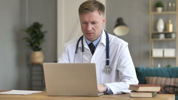 Thumbnail for Doctor Working On Laptop