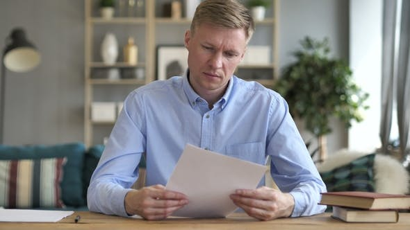 Thumbnail for Businessman Reading Documents at Work, Contract