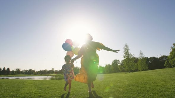 Thumbnail for Mom and Special Needs Girl Running with Baloons