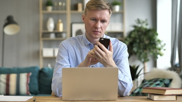 Thumbnail for Businessman Using Smartphone at Office Workplace