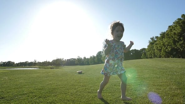 Cover Image for Little Special Needs Girl Running on Grass in Park