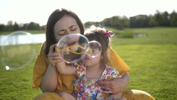 Thumbnail for Mother Blowing Soap Bubbles with Special Daughter