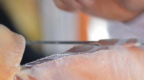 Cutting Serrano Ham Food with a Ham Knife