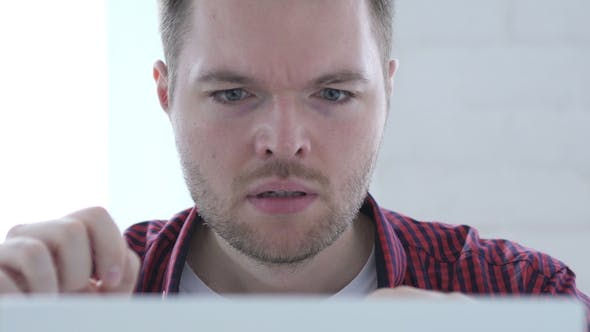 Thumbnail for Frustrated Man Reacting To Financial Problem