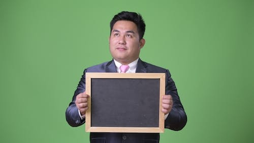 Young Handsome Overweight Asian Businessman
