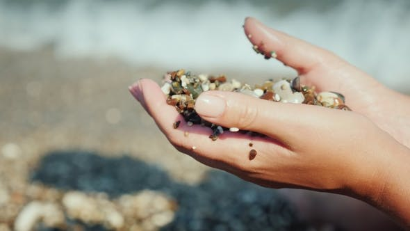 Cover Image for Female Hands Hold a Handful of Wet Pebbles. Rest on the Sea, Meditation Concept