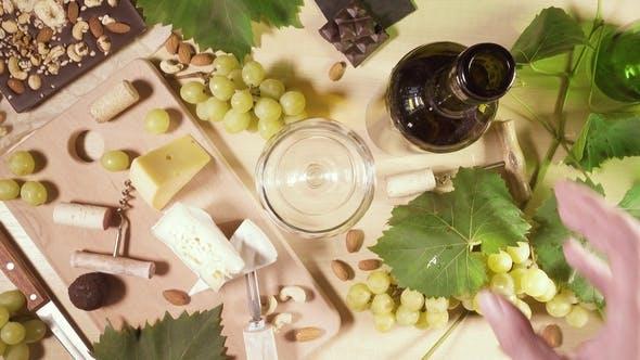 Thumbnail for Ein Glas und eine Flasche Wein und ein Snack Top View
