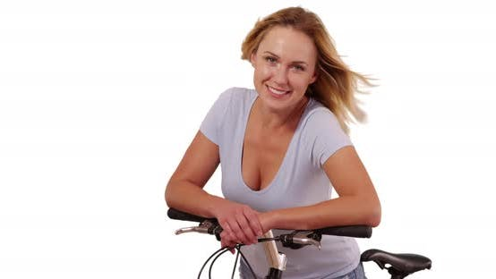 Thumbnail for Portrait of pretty white woman on bicycle looking at camera on white background