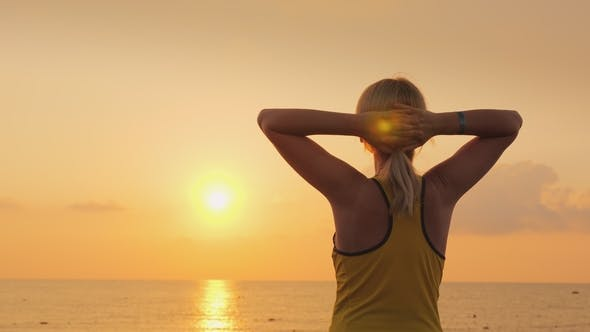 Thumbnail for Fitness Woman Admiring the Sunrise Over the Sea