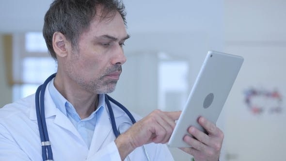 Thumbnail for Doctor Using Tablet Pc for Online Browsing