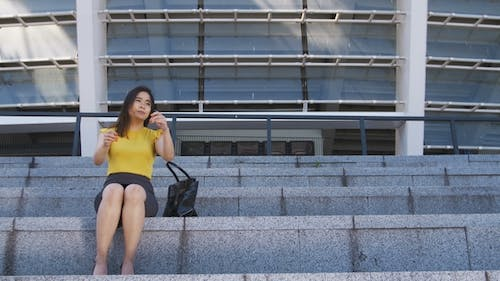 Frustrated Asian Business Woman Sitting on Stairs
