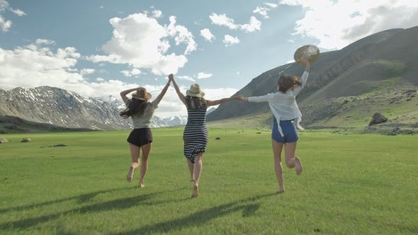 Thumbnail for Group Of Friends Hold Hands And Run Away Toward Mountain