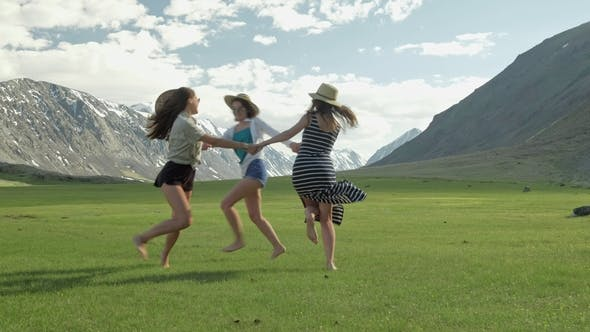 Thumbnail for Trendy Hipster Girls Having Fun Outdoor. Three Cute Women Are Whirling on Green Grass. Best Friends.