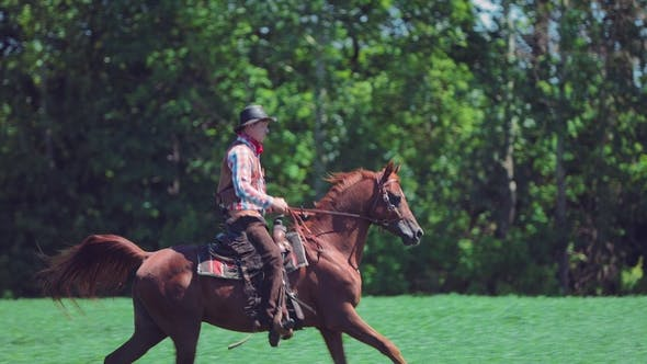 Senior and Experienced Horseman Galloping in a Field
