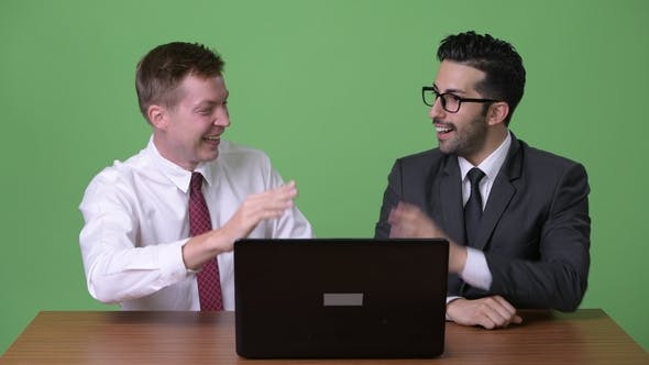 Thumbnail for Two Young Multi-ethnic Businessmen Working Together