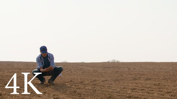 Thumbnail for Farmer Examining Soil Quality on Fresh Cultivated Field.