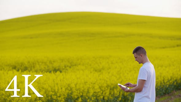 Thumbnail for Farmer Using Digital Tablet on Agricultural Field