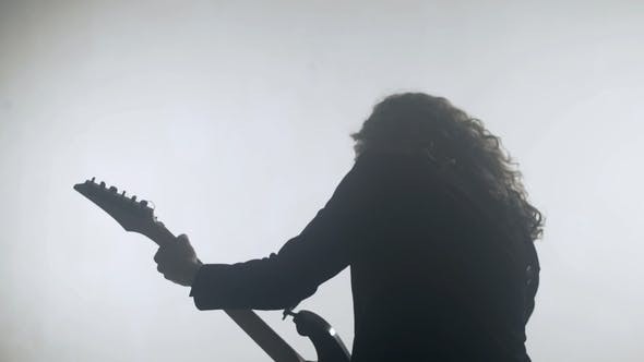 Thumbnail for Rock Musician Silhouette Playing Electric Guitar. Expressive Rock Guitarist