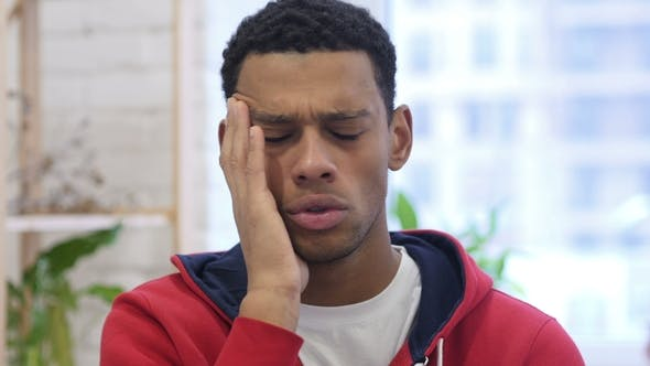 Cover Image for Afro-American Man Gesturing Headache, Stress