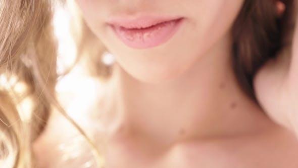 Thumbnail for Slender Girl Poses on the Camera in the Studio