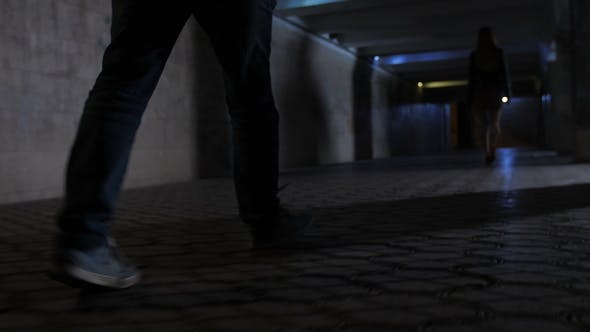 Thumbnail for Criminal's Legs Chasing Victim in Darkness