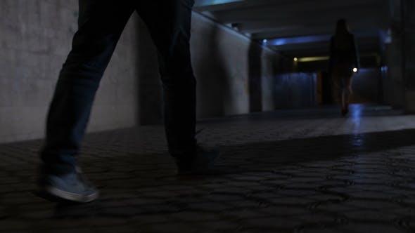 Criminal's Legs Chasing Victim in Darkness