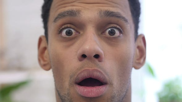 Shocked, Wondering Afro-American Man Indoor