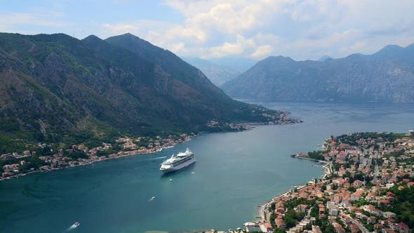 Aerial Beautiful View of Kotor Bay. Cruise Ship Docked in Beautiful Summer Day. .