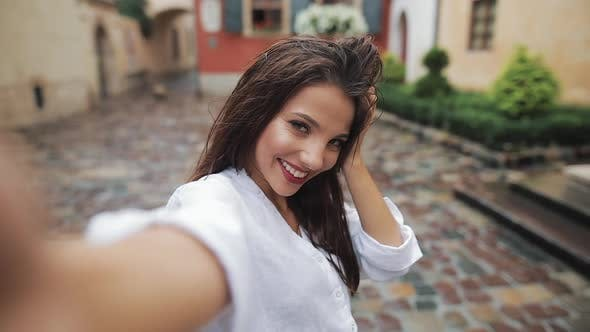 Cover Image for Selfie Time. Portrait of Young Attractive Woman Posing on the Camera with Different Emotion in the