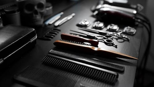 Stylish Equipment Table with Scissors and Trimmers and Dark Scull at the Barber Shop, Making of
