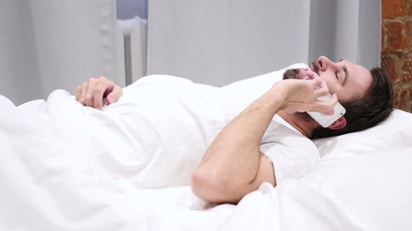 Thumbnail for Beard Man in Bed Dialing Call and Talking on Phone