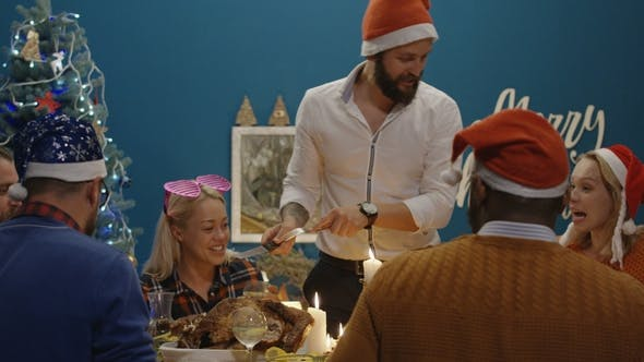 Thumbnail for Laughing Friends Having Roasted Turkey at Christmas Dinner