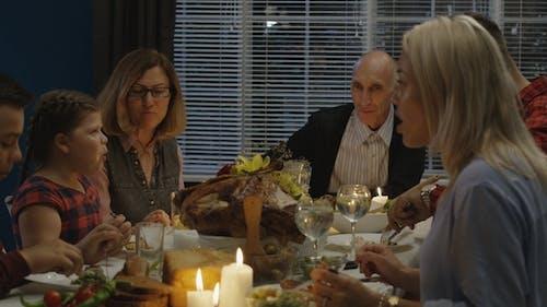 Family Having Thanksgiving Dinner at Home