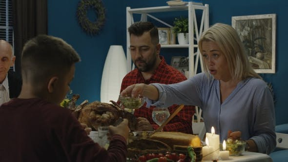 Thumbnail for Cheerful Family Enjoying Thanksgiving Day Dinner