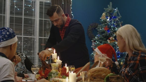 Thumbnail for Man Carving Turkey on Christmas Dinner
