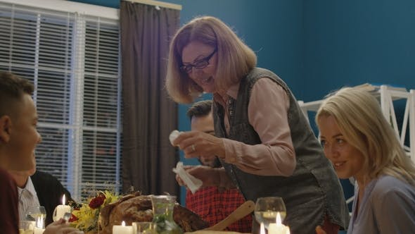 Cover Image for Woman Serving Holiday Turkey for Family