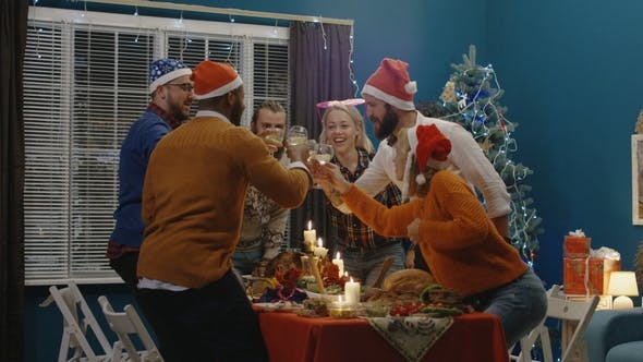 Thumbnail for Laughing Friends Making Toast on Christmas Celebration Party